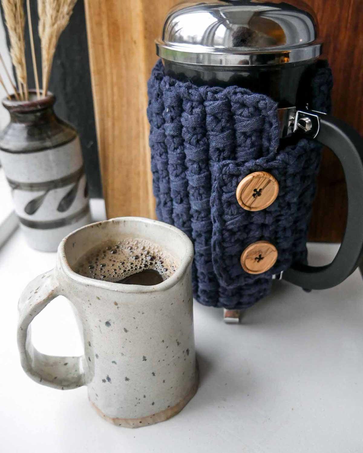 kaffevarmer og kaffefrakke til stempelkande